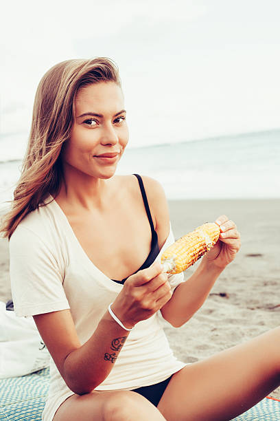 woman fresh face smiling on the beach of tropic island stock photo