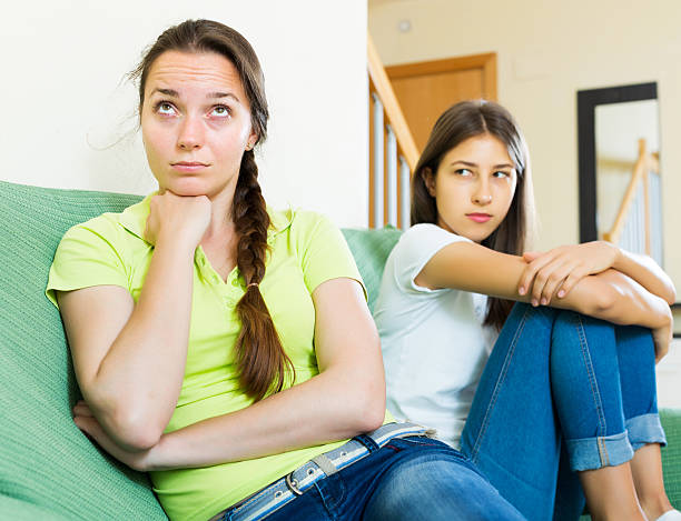 woman friends sitting and discontent - deplorable stock pictures, royalty-free photos & images