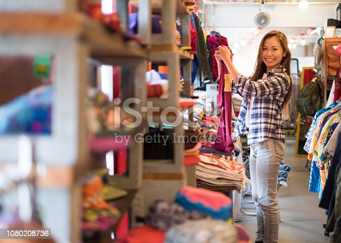 A woman from a casual fashion shop clerk.