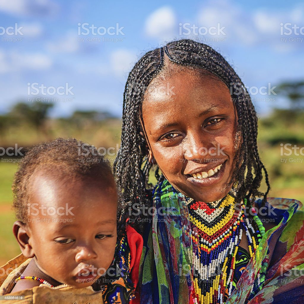 Woman from Borana tribe carrying her baby, Ethiopia, Africa royalty-free stock photo
