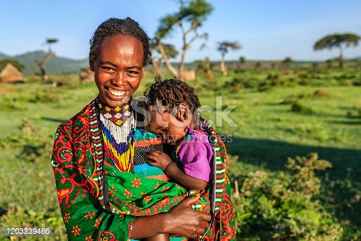 Woman from Borana tribe holding her baby, southern Ethiopia, Africa. The Borana Oromo are a pastoralist tribe living in southern Ethiopia and northern Kenya.