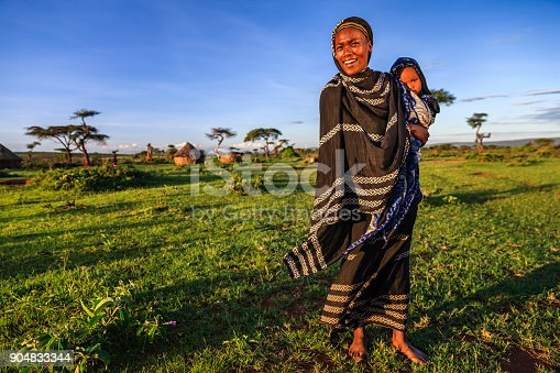 istock Woman from Borana tribe holding her baby, Ethiopia, Africa 904833344