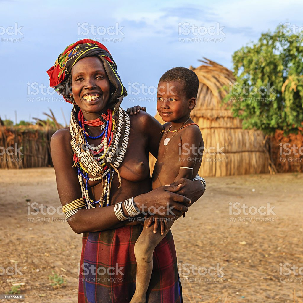 Woman from Erbore tribe holding her baby, Ethiopia, Africa stock photo