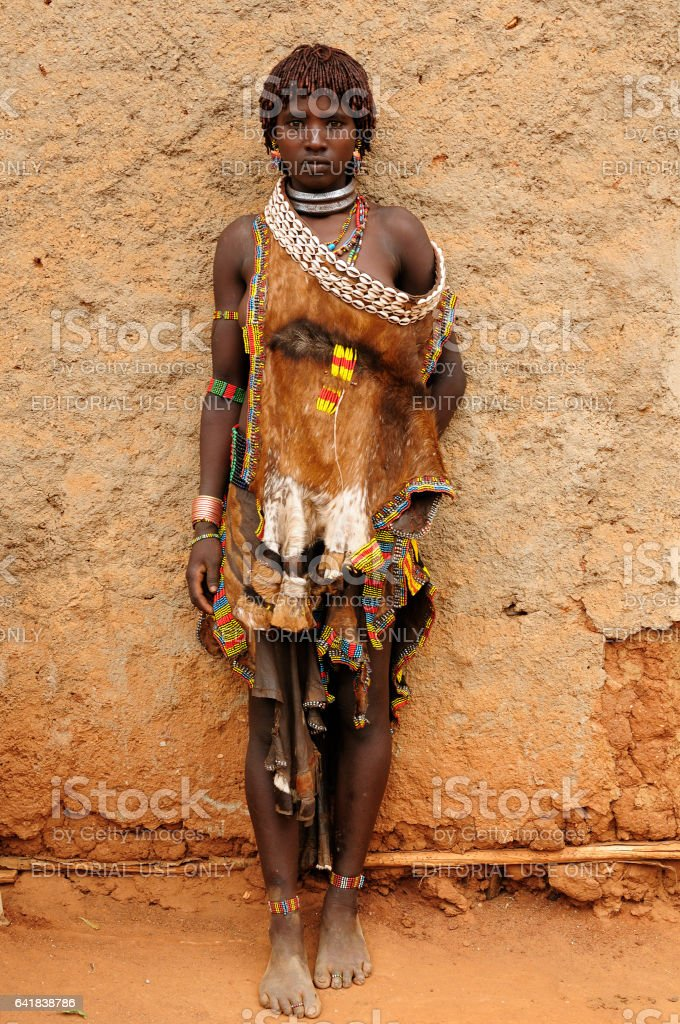 Woman from Hamer people is resting stock photo