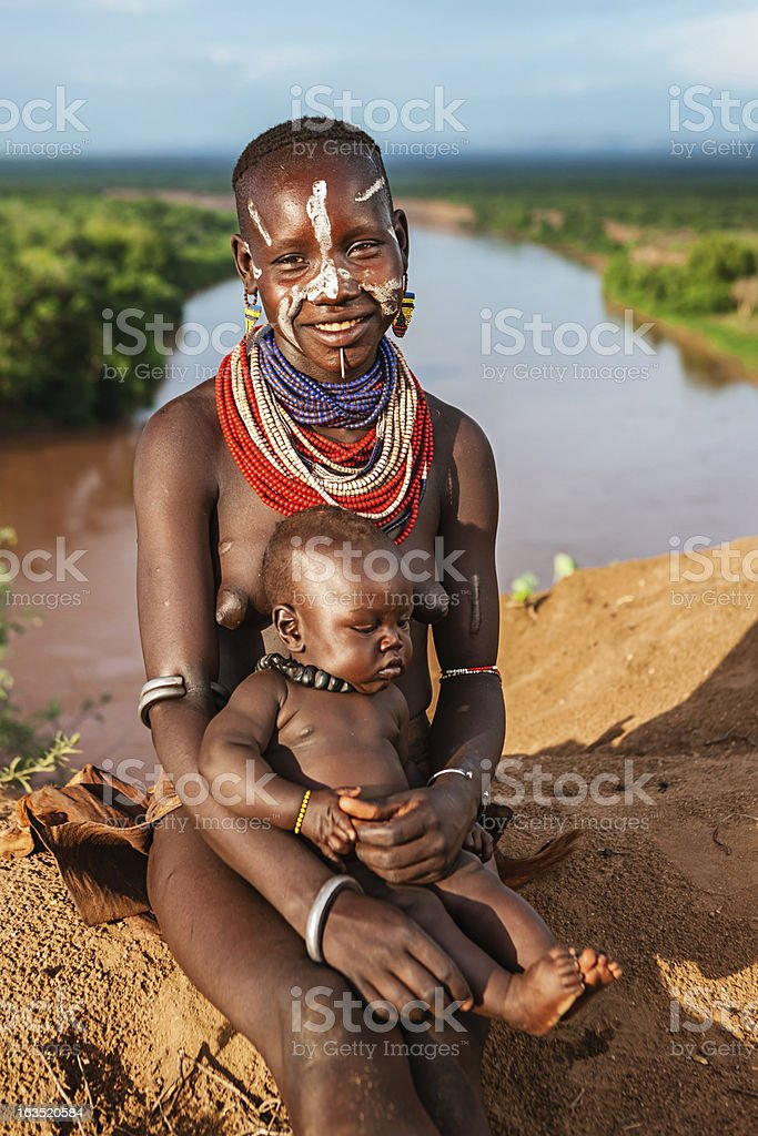 Woman from Karo tribe holding her baby, Ethiopia, Africa royalty-free stock photo