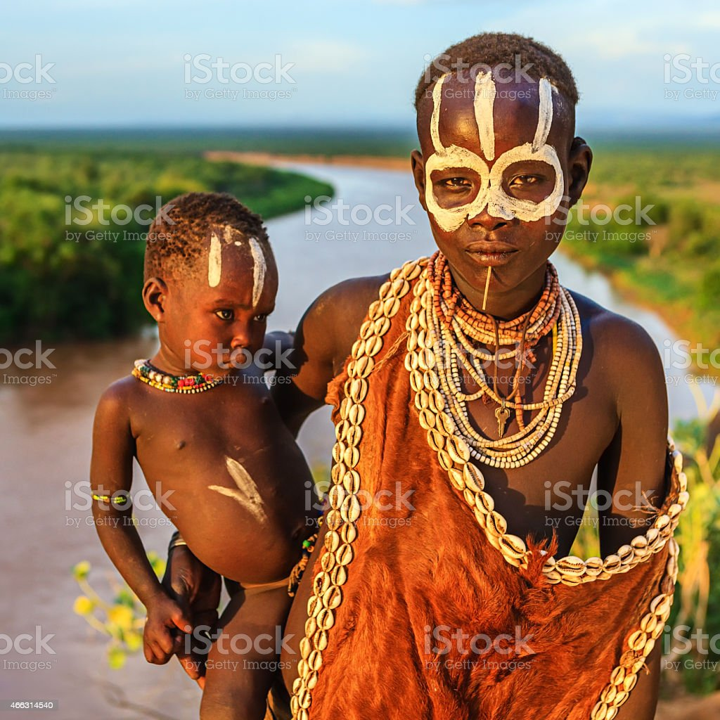 Woman from Karo tribe holding her baby, Ethiopia, Africa stock photo