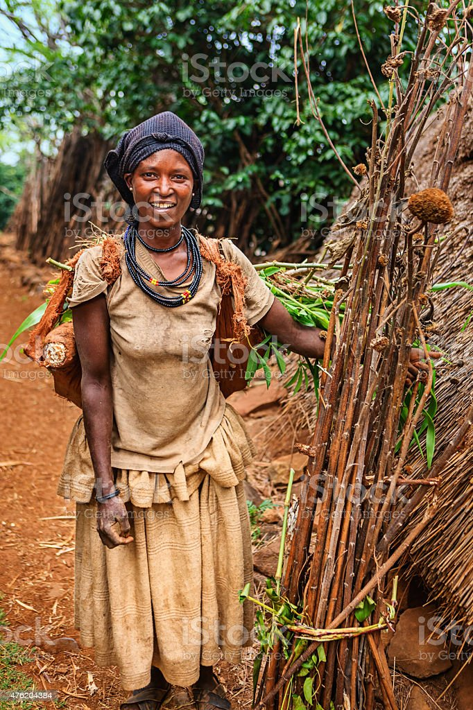 Woman from Konso tribe carrying brushwood, Ethiopia, Africa stock photo