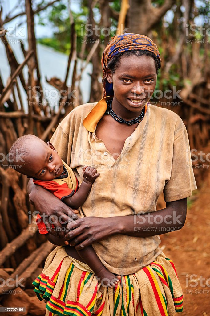 Woman from Konso tribe holding her baby, Ethiopia, Africa stock photo