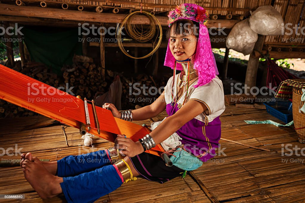 Woman from Long Neck Karen Tribe weaving stock photo