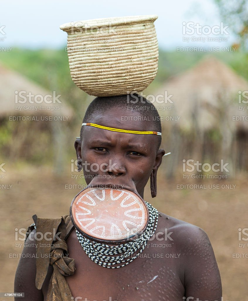 Woman from Mursi tribe. Mago National Park. Omo Valley, Ethiopia. stock photo