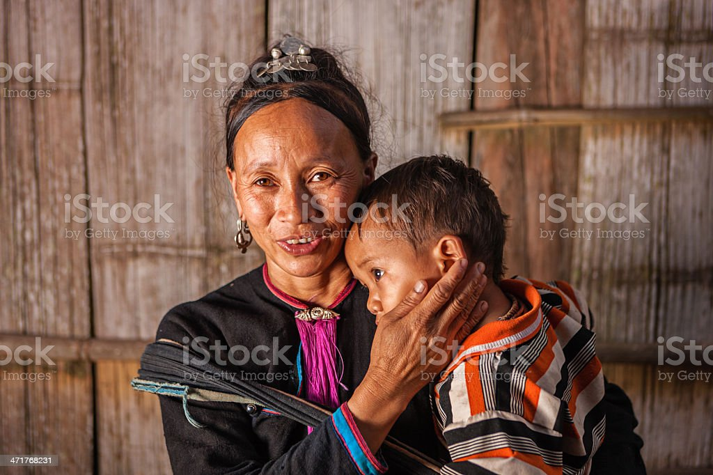 Woman from the hill tribe carrying her baby royalty-free stock photo