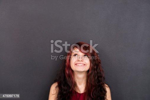 635680384 istock photo Woman Front of Blackboard 475397175