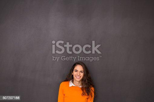 635680384 istock photo Woman Front of Blackboard 507207188