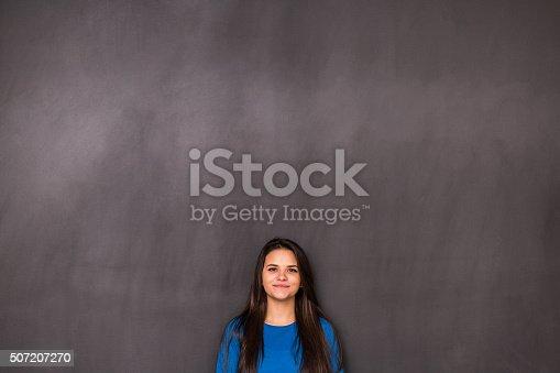 635680384 istock photo Woman Front of Blackboard 507207270
