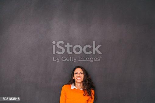 635680384 istock photo Woman Front of Blackboard 508183548