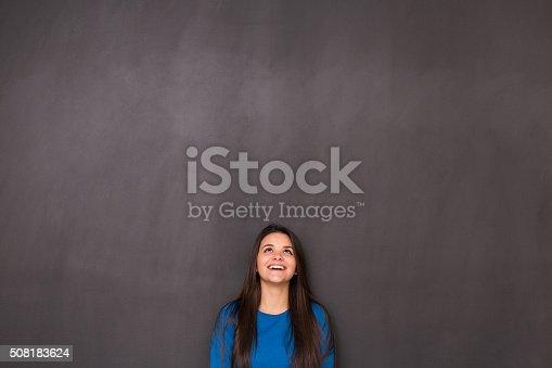 635680384 istock photo Woman Front of Blackboard 508183624