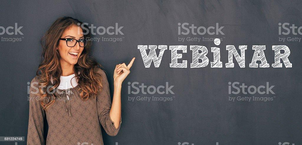 Woman Front of Blackboard stock photo