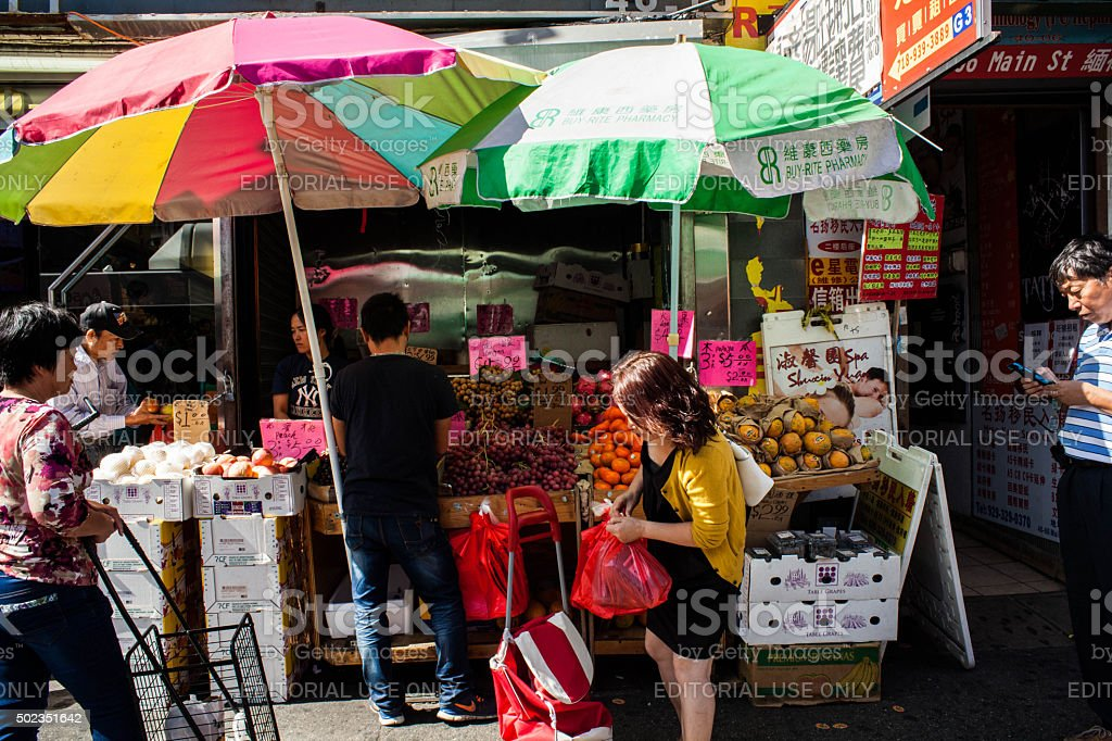 Woman Fruit Vendor on Chinatown Sidewalk stock photo