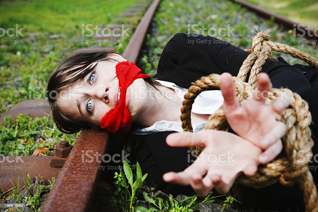 woman gagged and bound to railroad track pleads for