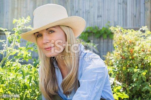 istock Woman gardening 531421566