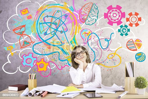 Attractive young woman at workplace generating creative ideas. Concrete wall with sketch in the background. Success concept