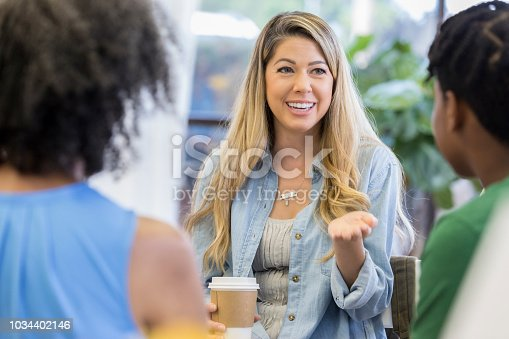 istock Woman gestures during support group meeting 1034402146