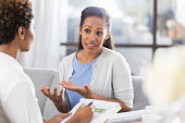 istock Woman gestures while talking with mental health professional 917744790