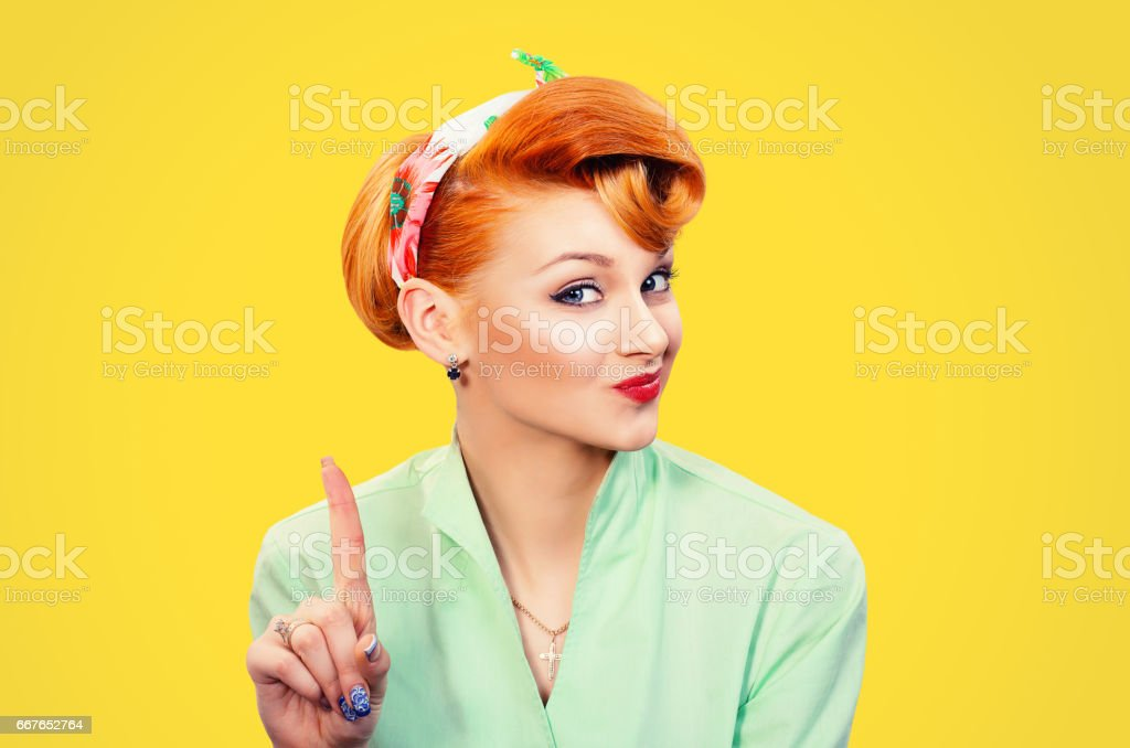 woman gesturing a no sign. Closeup portrait unhappy, serious pinup retro style girl raising finger up saying oh no you did not do that yellow background. Negative emotions facial expressions, feelings stock photo