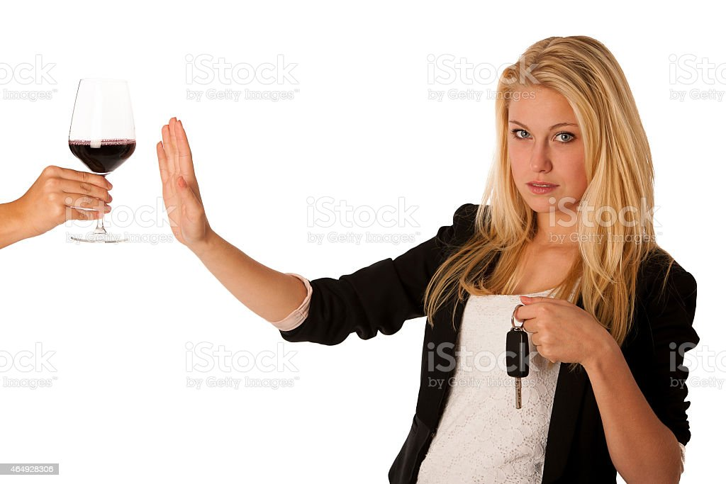 woman gesturing don't drink and drive gesture stock photo