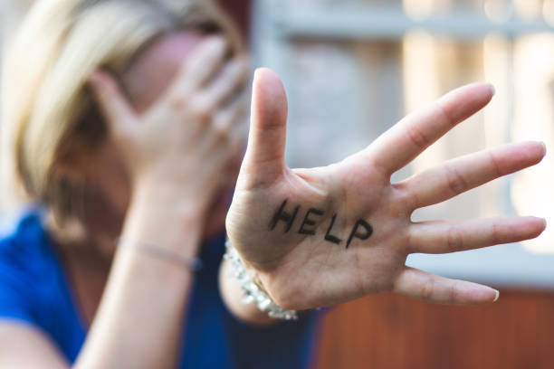 woman gesturing help sign on her hand. - victim stock pictures, royalty-free photos & images
