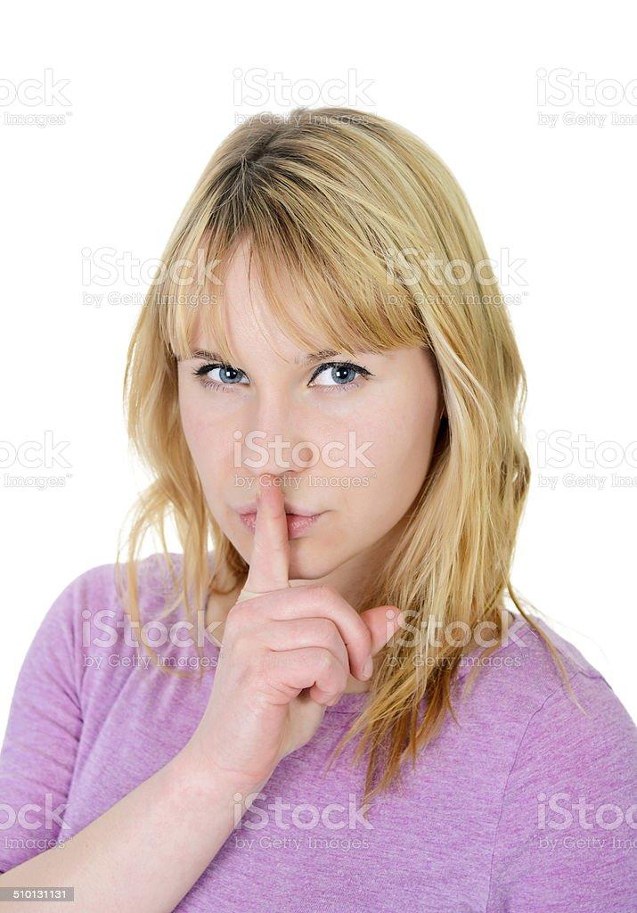 woman gesturing hush stock photo