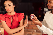 istock Woman Gesturing No To Engagement Ring During Date In Restaurant 1201185642