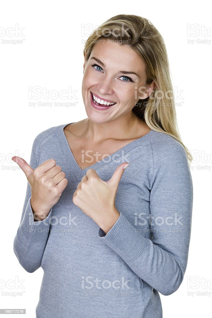 Woman gesturing thumbs up royalty-free stock photo