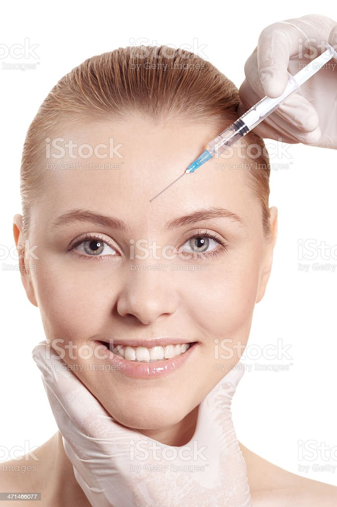 woman gets an injection in her face royalty-free stock photo