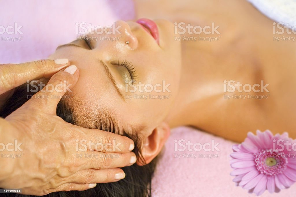 Woman gets head massage royalty-free stock photo
