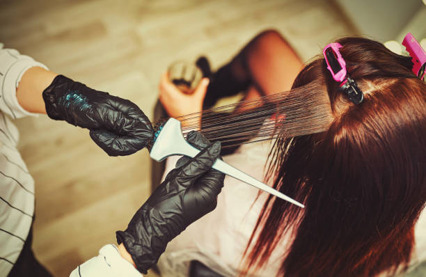 Woman gets new hair color at the salon stock photo