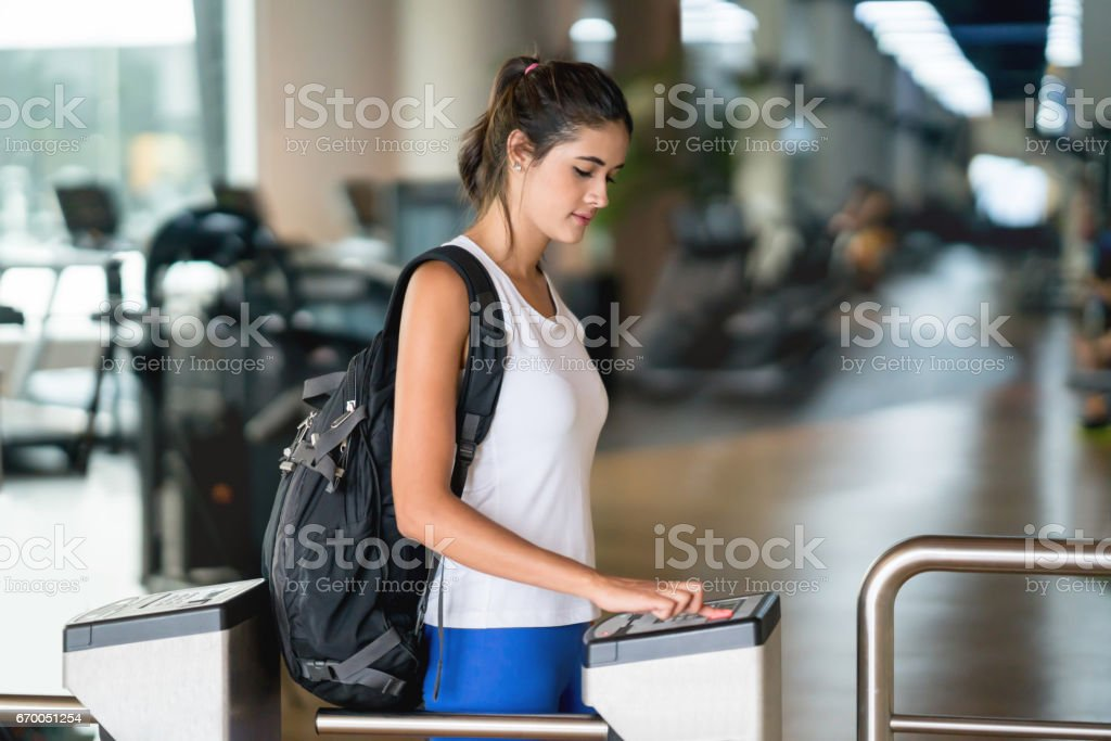 Woman getting a fingerprint scan to access the gym stock photo