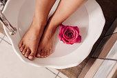 Woman getting a foot scrub spa treatment\nPhoto taken indoors