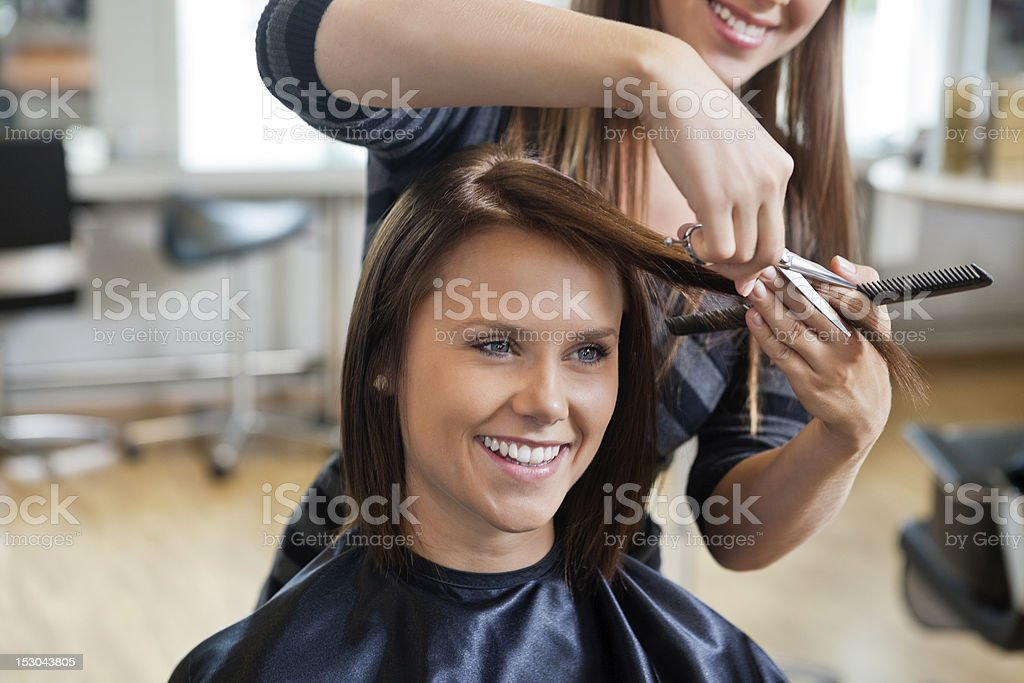 Woman Getting a Haircut stock photo