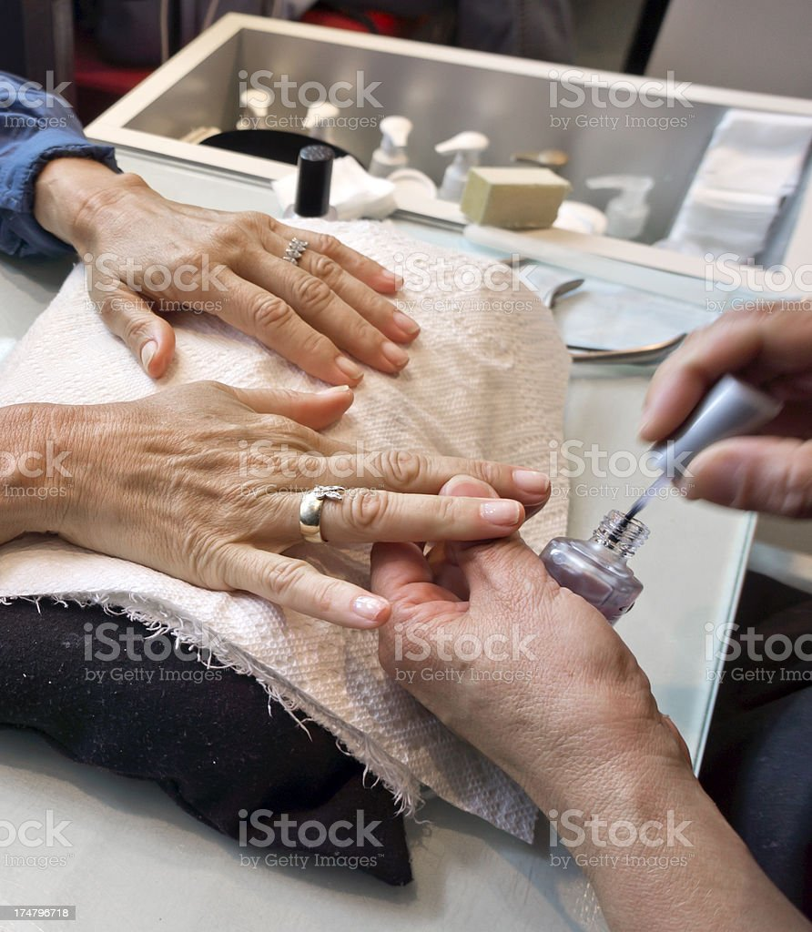 Woman getting a manicure, close-up royalty-free stock photo