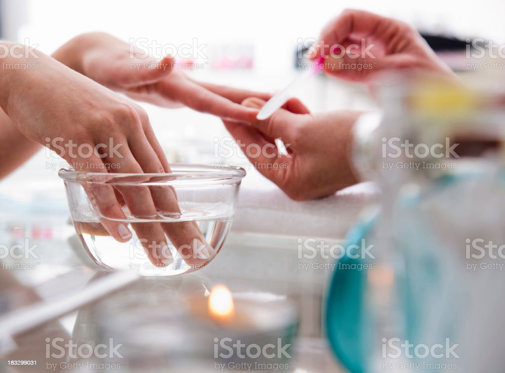Woman Getting a Manicure royalty-free stock photo