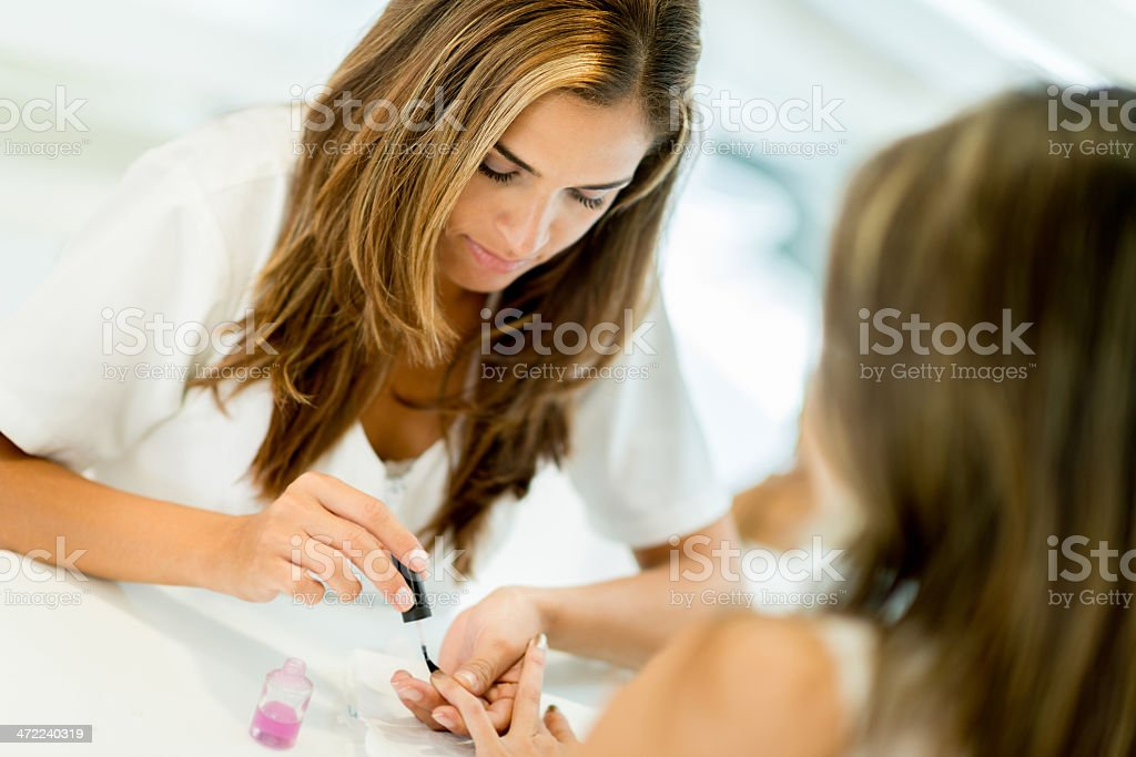 Woman getting a manicure stock photo