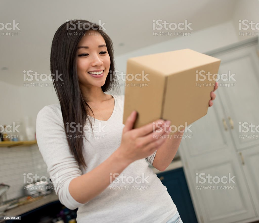 Woman getting a package on the mail stock photo