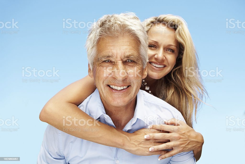 Woman getting a piggy back ride on man royalty-free stock photo