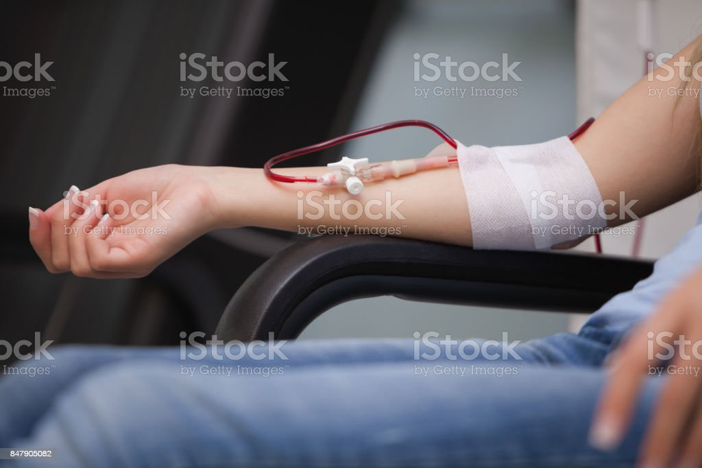Woman getting a transfusion stock photo