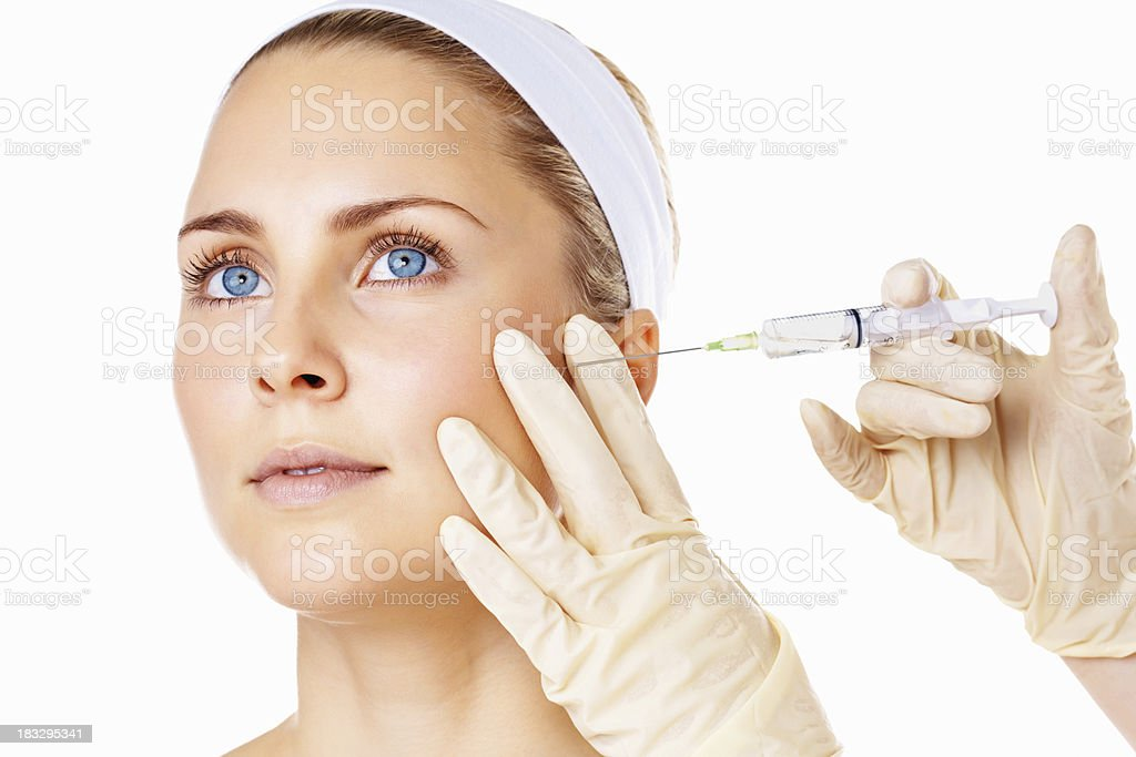 Woman getting Botox beauty treatment royalty-free stock photo