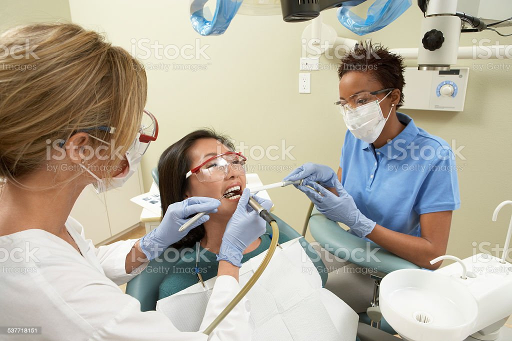 Woman Getting Dental Work Done stock photo