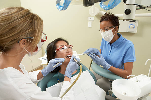 woman getting dental work done - dental assistant stock photos and pictures