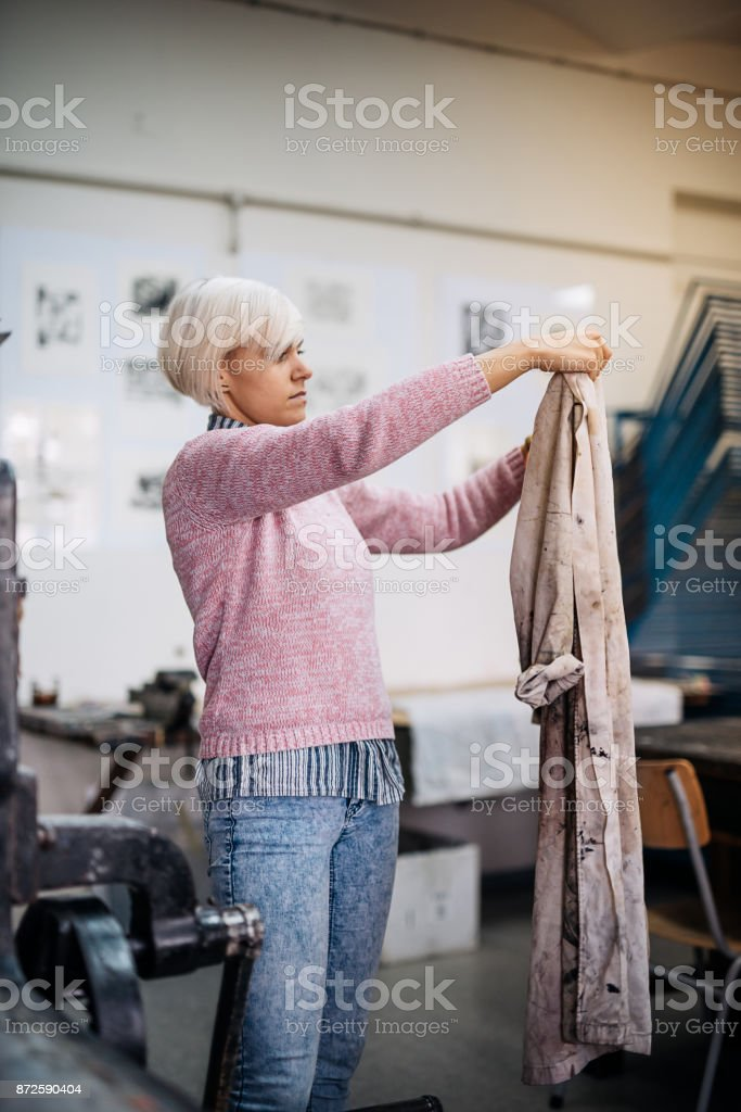 Woman getting dressed in working uniform stock photo