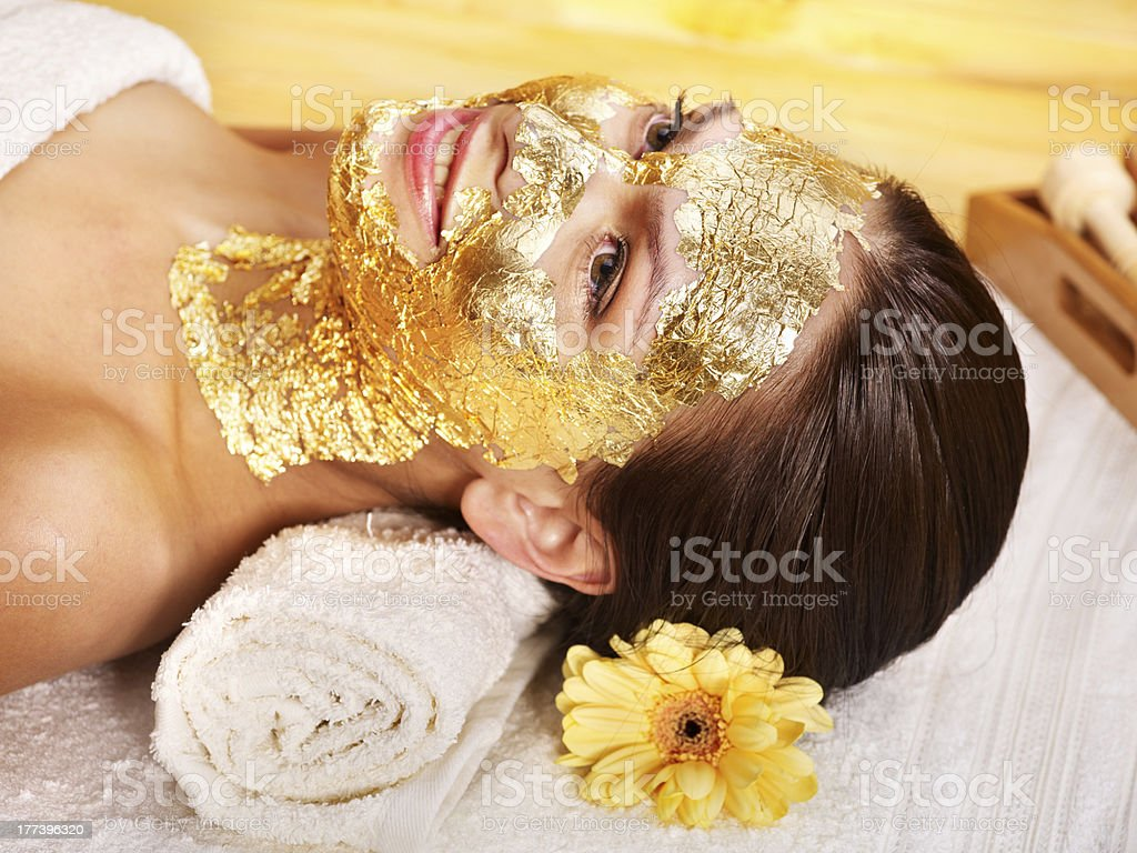 Woman getting  facial mask . stock photo